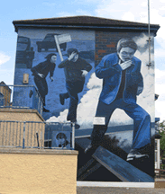 Derry youth running from sarecen. Bogside mural. Photograph by Diarmuid McGowan